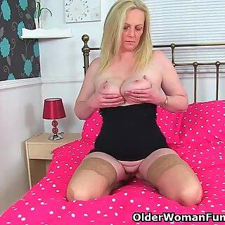 british and buxomy milf Fiona puts her fake penis to work