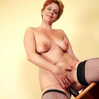 Amateur grandma masturbating on the couch