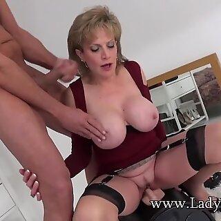 UK cougar rides sybian saddle and gargles a huge cock