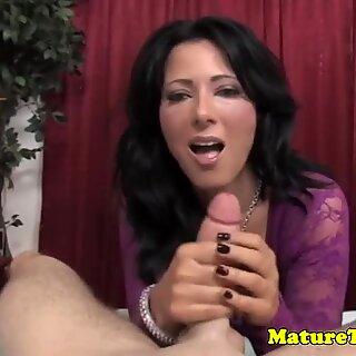 Beautiful busty stockinged MILF jacking cock