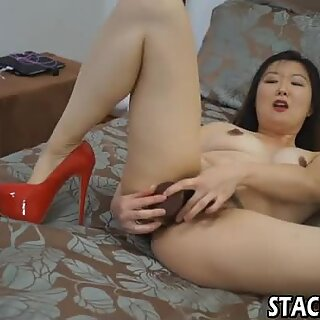 Asian in high heels masturbates