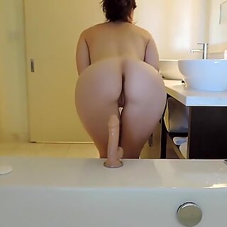 Dildo ride in the bathroom